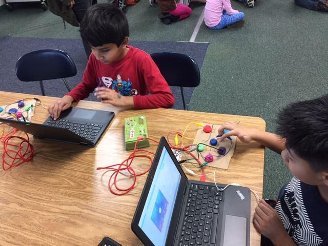 Students working with Makey Makey and Chromebooks